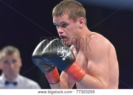 NOVOSIBIRSK, RUSSIA - NOVEMBER 29, 2014: Viacheslav Kislitsyn of Ukraine in the match against Boris Georgiev of Bulgaria during AIBA Pro Boxing tournament. The winners will go to the Olympics-2016
