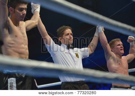 NOVOSIBIRSK, RUSSIA - NOVEMBER 29, 2014: Draw in the match Evaldas Petrauskas of Lietuva (right) vs Carlos Aquino of Argentina during AIBA Pro Boxing tournament. The winners will go to the Olympics