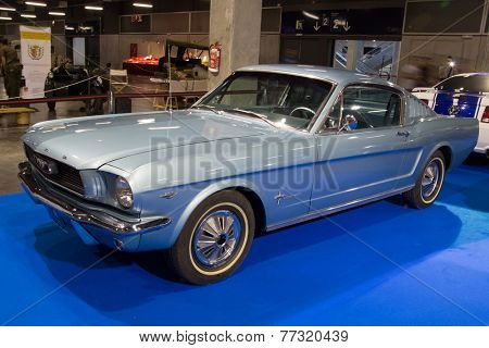 VALENCIA, SPAIN - OCTOBER 17, 2014: A blue classic Ford Mustang at the Retro Auto and Moto Valencia Classic Car Show. The Ford Mustang was introduced on April 17, 1964 at the New York World's Fair.