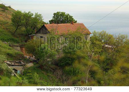 Fisherman hut on the mountain coast