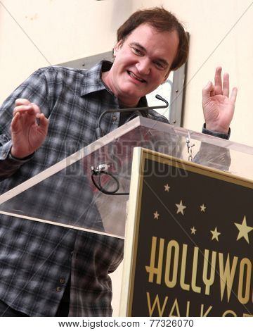 LOS ANGELES - DEC 1:  Quentin Tarantino at the Christoph Waltz Hollywood Walk of Fame Star Ceremony at the Hollywood Boulevard on December 1, 2014 in Los Angeles, CA