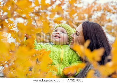 Happy Mom And Toddler Boy On Walk