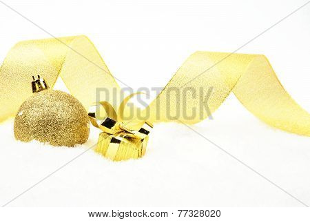 Golden Christmas Gift,bauble With Golden Ribbon On Snow