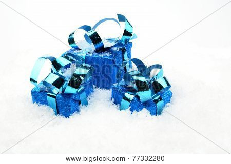 Three Blue Christmas Gifts On Snow