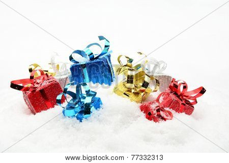 Three Blue,red,golden,silver Christmas Gifts On Snow
