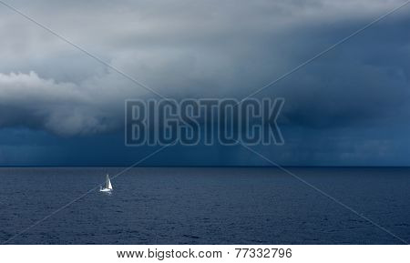 Lonely boat in front of stomy ocean clouds