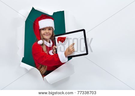 Opening the holidays season online - little girl with tablet computer pointing to copy space