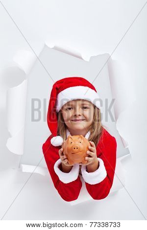 Share your goods with your loved ones this holiday season - little santa girl giving you a piggy bank
