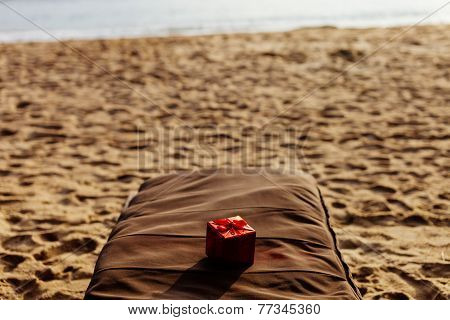 Gift In Red Box On The Beach Resort