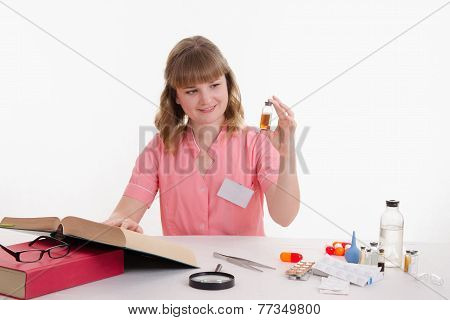 Pharmacist Studying Under Directory Properties Of Liquid In Vial