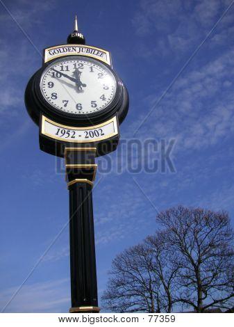 Clock Against Blue Sky