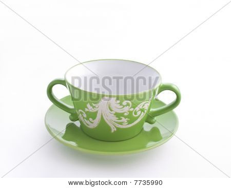 Empty Green Cup On A Saucer
