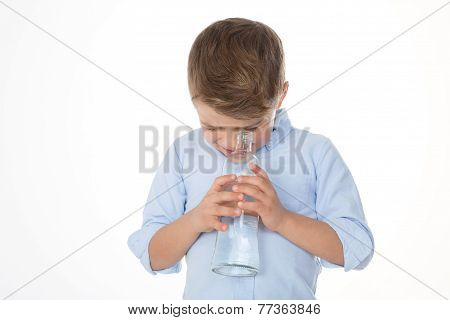 Kid Looking Into A Flask
