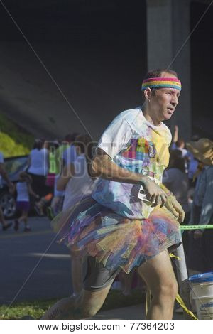 Man Racing In A Colorful Tutu In The Color Run