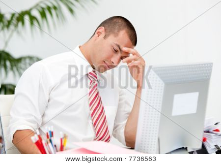 Stressed Businessman Working At A Computer