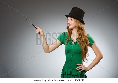 Woman magician wearing green dress
