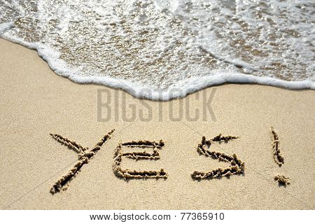 Yes Written On Sandy Beach Near Sea