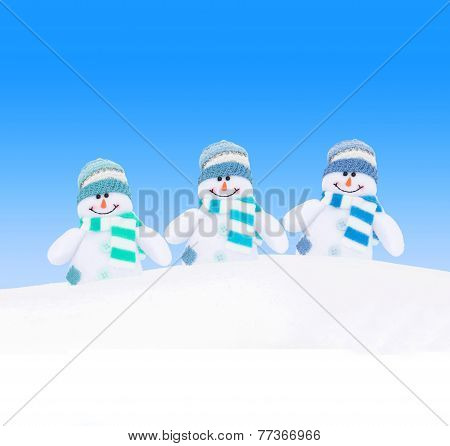 Happy Winter Snowmen Family Against Blue Sky