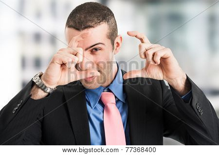 Businessman framing a scene with his fingers