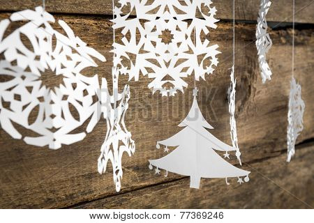 Christmas decorations snowflake ,christmas tree paper hanging over wooden background