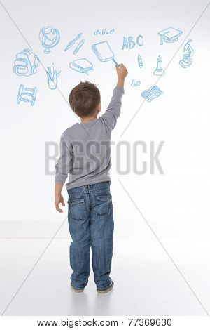 Child Holds A Chalk In His Hand