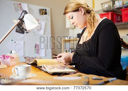 Young Woman Scrapbooking At Home