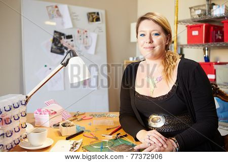 Portrait Of Young Woman Making Jewelry At Home