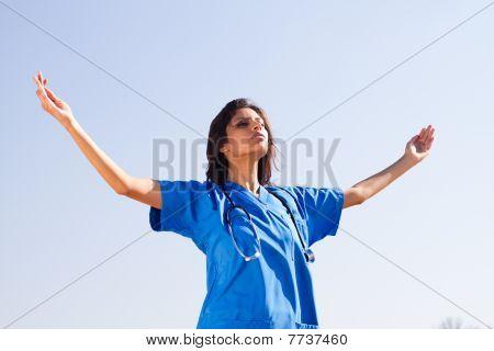 young spiritual nurse on beach