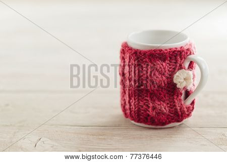 Cup in sweater
