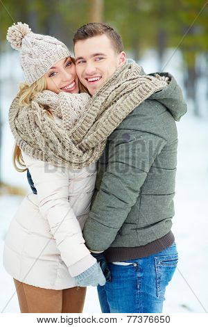 Young amorous couple posing outdoors