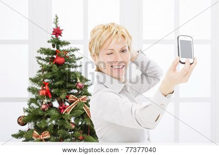Business woman take self photo and christmas tree