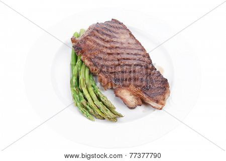 meat table : rare medium roast beef fillet asparagus served on white plate  isolated over white