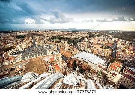 Famous Saint Peter's Square in Vatican and aerial view of the city, Rome, Italy.