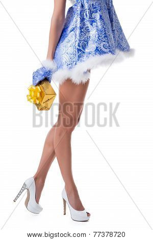 Close-up of leggy Snow Maiden posing with gift