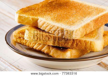 Three  Slices Toast Bread On Wooden Background.