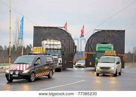 Pilot Cars And Two Trucks Hauling Oversize Loads