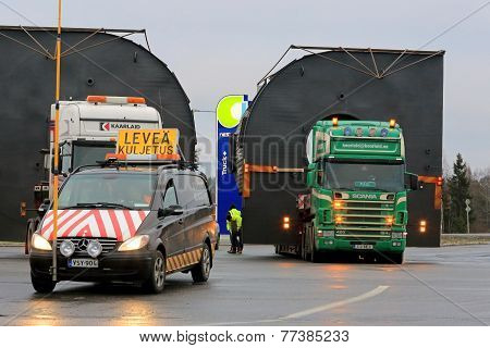 Pilot Car And Two Trucks With Oversize Loads