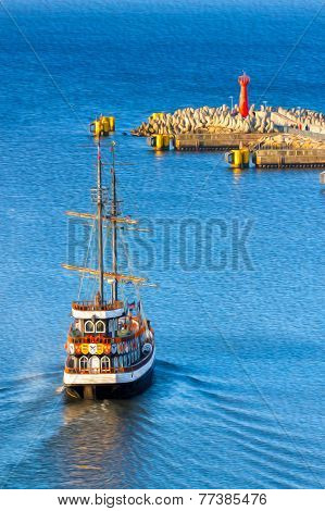 Oil Painting Style Picture Of Historic Sailing Ship Leaving Port.