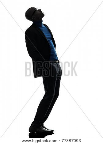 one african black man standing looking up in silhouette studio on white background