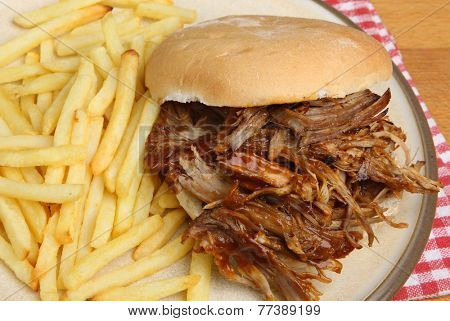 Pulled pork sandwich with fries.