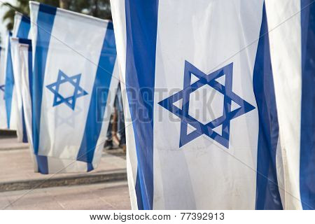 Israeli flags held vertically