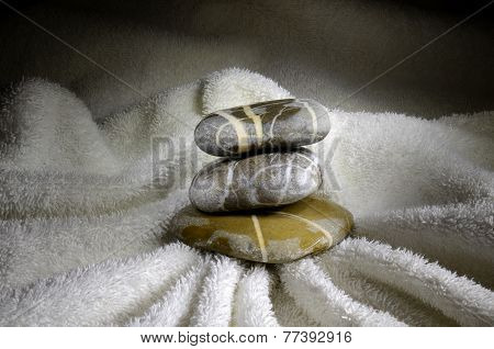 Stack Of Pebbles On Towel