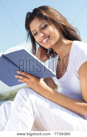 relaxed indian woman reading