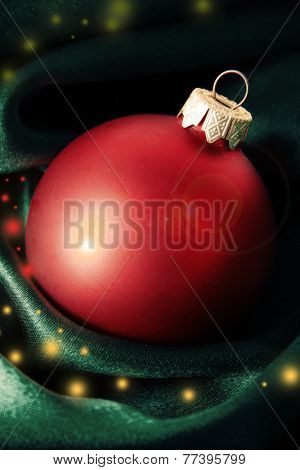 Beautiful Christmas ball on green satin cloth