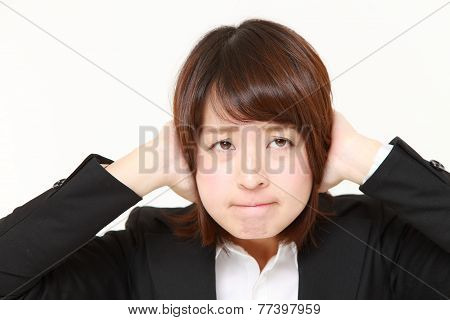 businesswoman suffers from noise