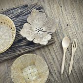 stock photo of handicrafts  - thai handicraft on old wooden plate background - JPG