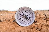 picture of orientation  - Orientation Concept Metal Compass on a Rock in the Desert - JPG