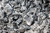stock photo of ashes  - ashes of burned wood on an abstract gray texture - JPG