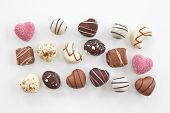 foto of truffle  - Selection of chocolate candy and truffles in heart shape - JPG