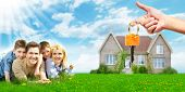 pic of residential home  - Happy family near new home - JPG